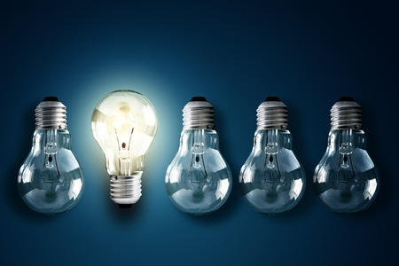 8970947 - illuminated light bulb in a row of dim ones concept for creativity, innovation and solution