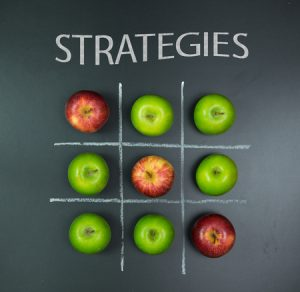 61641760 - strategies concept using apples in tic tac toe gam